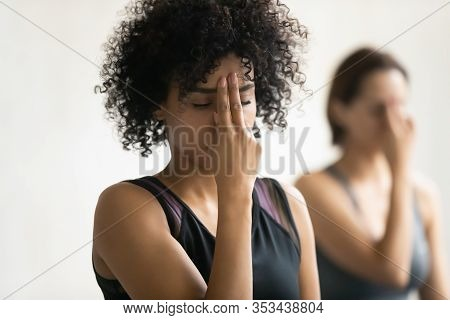 African Woman During Yoga Class Do Alternate Nostril Breathing Practice