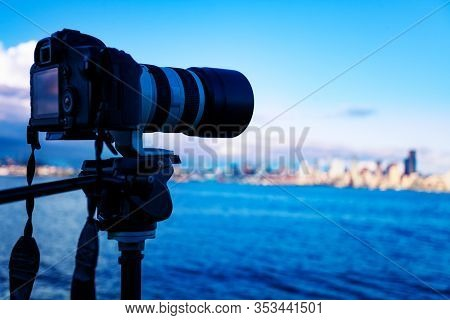 Camera On Tripod Photographing American City Panorama With Long Lens