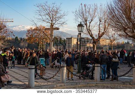 Granada, Spain - January 6, 2017: People Observe Alhambra Palace From Mirador San Nicolas Viewpoint