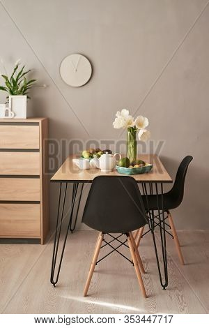 Loft Style Dining Room. Dining Table With Chairs. Mock Up Interior Photo. Black Chairs At Dining Tab