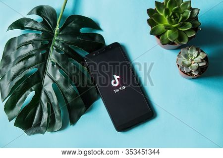 Tver, Russia-february 28, 2020 Tik Tok Logo On The Smartphone Screen With A Monstera Leaf And Succul
