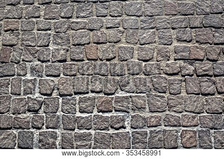 Cobblestone Pavement Texture Background. Top View Of Stone Road. Detail Of Granite Sidewalk Taken Fr
