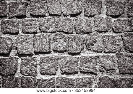 Cobblestone Pavement Texture Background. Detail Of Granite Sidewalk. Top View Of Stone Road. Vintage