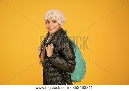 Backpack For Keeping Belongings Secure On The Go. Little Child Wear School Backpack On Yellow Backgr