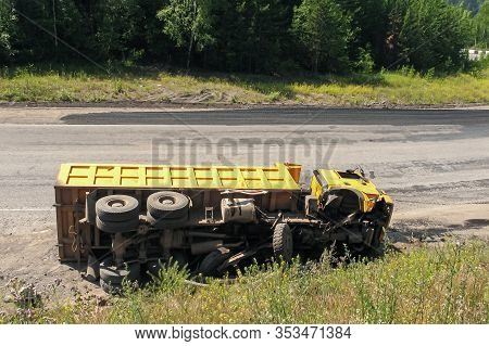 An Overturned Truck On An Highway In An Accident.