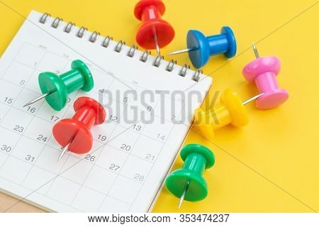 Colorful Oversized Thumbtack Or Pushpin On White Calendar On Yellow Background Using As Full Booked,