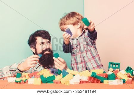 Family Day. Small Boy With Dad Playing Together. Father And Son Play Game. Love. Child Development.