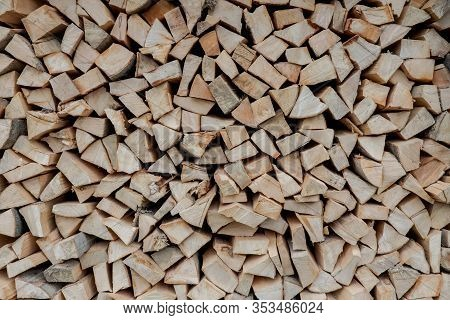 Stacks Of Firewood. Preparation Of Firewood For The Winter. Pile Of Firewood.firewood Background
