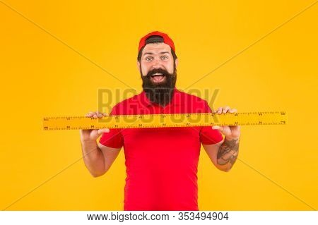 Perfect Size. Bearded Man With Big Measuring Instrument. Measuring With Ruler. Size Measurement. Mea