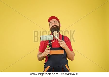 Man Bearded Laborer Painting. Repair And Renovation. Builder Regular Worker Hold Paint Roller And Br