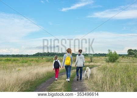 Active Healthy Lifestyle, Children Outdoors With Dog, Family Boy And Girls Walking Along Country Roa