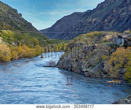 Tourists On Kawarau River Jet Boat Adrenalin Thrill Riding Through The Canyon In New Zealand