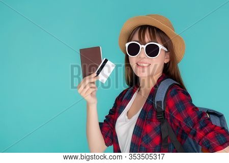 Beautiful Young Asian Woman Wear Hat And Sunglasses With Showing Credit Card And Passport To Travel