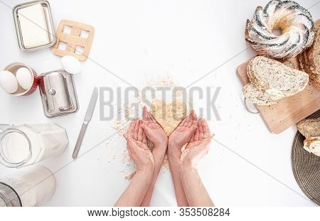 The View From The Top. Mom And Daughter Prepare Pastries In The Kitchen. The Concept Of A Loving Fam