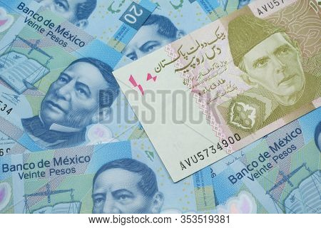 A Close Up Image Of A Gray And Pink Twenty Pakistani Rupee Bank Note With Mexican Twenty Peso Bank N