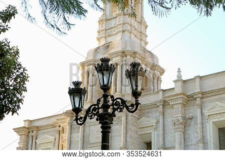 Gorgeous Vintage Wrought Iron Street Lamp Against White Volcanic Stone Church Of Arequipa Cathedral,