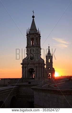 Bright Setting Sun Shining Through The Bell Tower Of Basilica Cathedral Of Arequipa, Historic Church