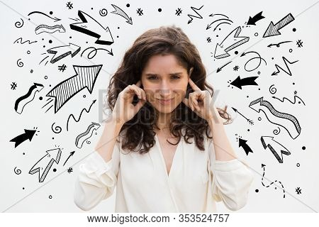 Irritated Young Woman Plugged Ears With Fingers. Angry Lady With Closed Eyes Posing In Studio. Irrit