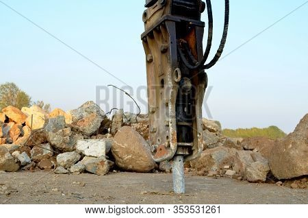 Excavator With Hydraulic Breaker Hammer For The Destruction Of Concrete And Hard Rock At The Constru