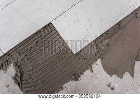 Ceramic wood effect tiles and tools for tiler on the floor  unfinished laying floor tiles  Floor tiles installation
