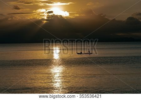 Tropical Sunset At The Beach With Palms At Dawn , St.marie , Madagascar