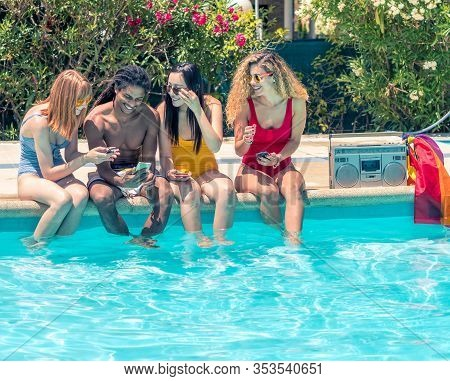 Group Of People Of Different Ethnic Groups With Bathing Suits Of Different Colors With The Mobile In