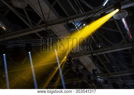 Spotlights. The Stage For The Performance Is Illuminated By Floodlights. A Ray Of Light Breaks Throu