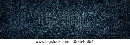 Old Navy Blue Textured Plaster Wall. Rough Stucco Wide Texture. Dark Gloomy Grunge Large Background