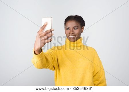 Beautiful Smiling Woman Taking Selfie With Smartphone. Attractive Young Lady Posing For Self Portrai
