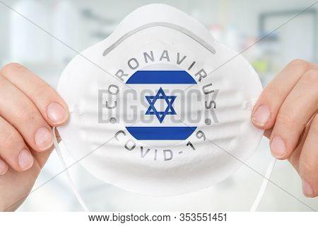 Respirator Mask With Flag Of Israel - Coronavirus Covid-19 Epidemic Concept
