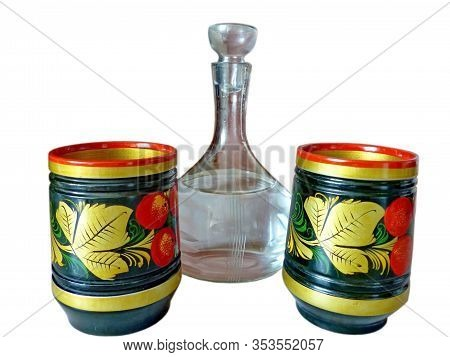 Bright Khokhloma Stacks And A Decanter Of Vodka, Isolated On A White Background. Khokhloma Is An Old