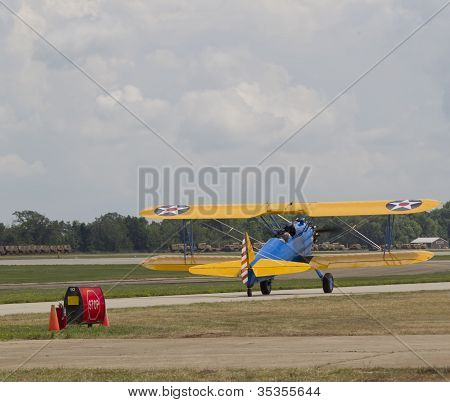 Us Army Bi Plane Fighter Lifting Off On Runway