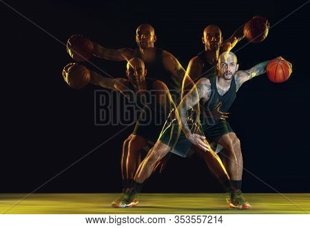 Young Basketball Player Of Team In Sportwear Training, Practicing In Action, Motion Isolated On Dark