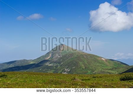 Mount Hoverla In Carpathian Mountains On A Background Of Sky In Summer Day. View From Chornohora Ran