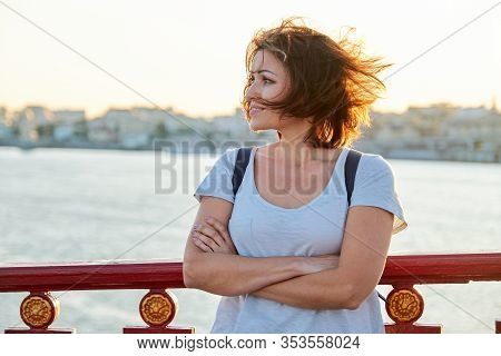 Outdoor Portrait Of Mature Beautiful Happy Woman With Arms Crossed, Female Walking With Backpack On