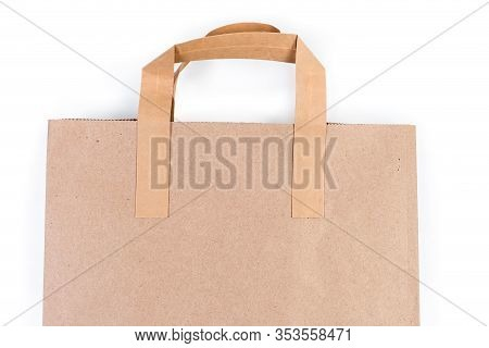 Paper Shopping Bag, Upper Part With Paper Handles Made With Light Brown Unbleached Paper Close-up On