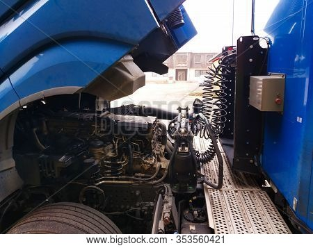 Space Between Truck Cab And Trailer. Folded Tractor Connected With Hoses And Connections.tilted Blue
