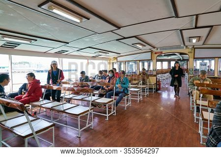 HONG KONG, CHINA - CIRCA JANUARY, 2019: people on a Star Ferry crossing Victoria Harbour. The Star Ferry is a passenger ferry service operator and tourist attraction in Hong Kong.