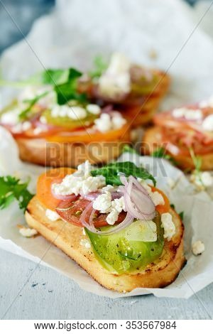 Italian Bruschetta (sandwich, Crostini, Tapas, Toast) With Fresh Tomatoes, Ricotta, Herbs, Onions, O