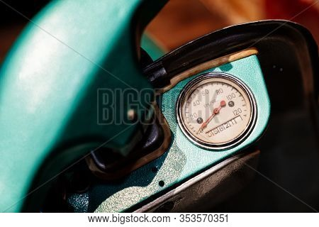 Speedometer On A Turquoise Collectible Retro Moped.