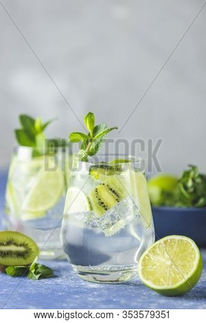 Two Detox Water, Mojito Or Martini Tonic Cocktail With Kiwi, Lime, Ice, Mint. Summer Fresh Lime Soda