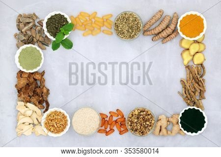 Herb and spice selection to ease irritable bowel syndrome used in natural & chinese herbal medicine with vitamin capsules & dietary supplement powders forming a background border with copy space.