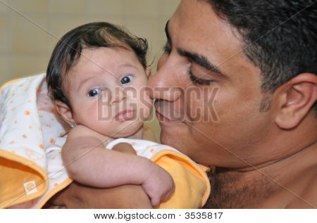 A Father Holding His Baby