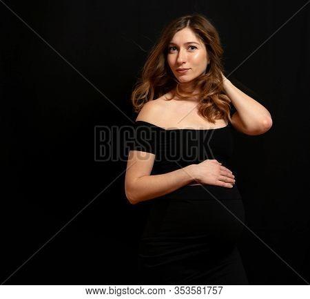 Studio Shoot Of Beautiful Gorgeous Pregnant Woman On Black Background