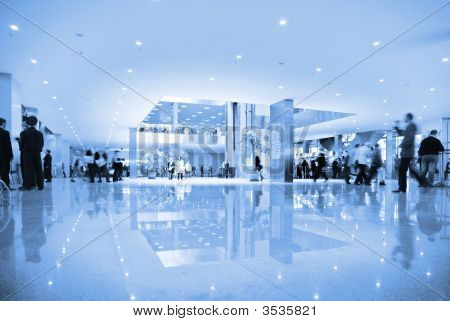 People In Hall Of Business Center