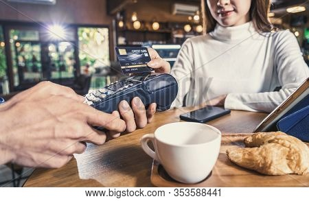 Closeup Asian Customer Woman Paying With Credit Card Via Contactless Nfs Technology To Asian Small C