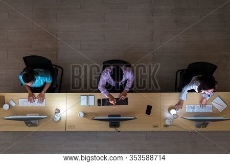Top View Of Asian Male Customer Care Service Working Hard Late In Night Shift At Office,call Center