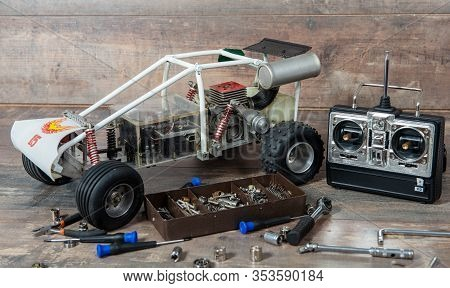Radio-controlled Car Model With Tools For Repairing Rc Buggy Models And A Control Panel.