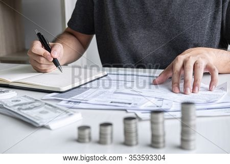 Images Of Stacking Coin Pile And Husband Using Calculator To Calculating Expenditure Receipt Bills O