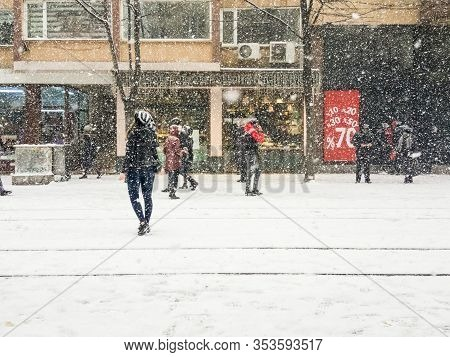 Winter Snowstorm Blizzard In Eskisehir  With Heavy Snow Falling. Street Covered By Snow And People C